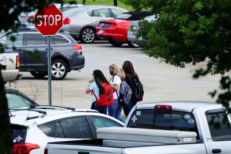 Image: Students are seen in the Jefferson High School parking lot as school started amid coronavirus disease (COVID-19) jitters in Jefferson