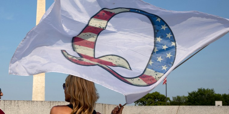 Image: QAnon supporters wait for the military fly