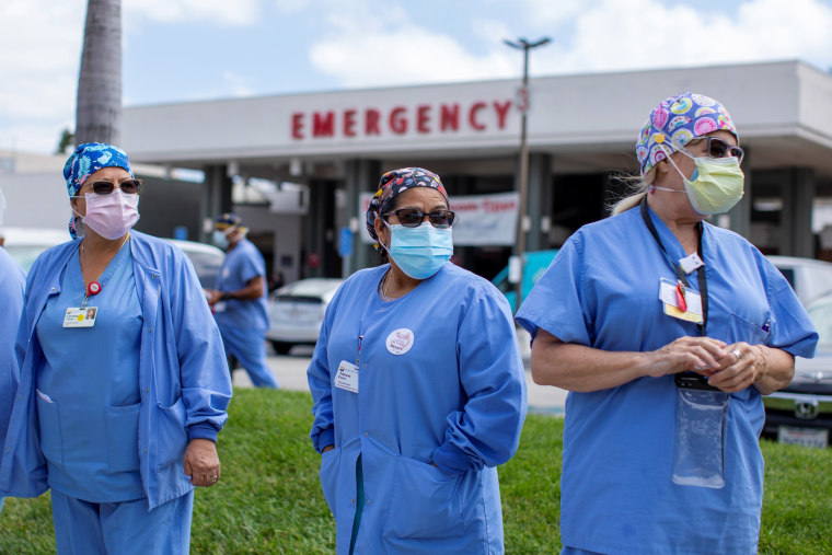 Image: Healthcare workers protest outside their hospital during the outbreak of the coronavirus disease (COVID-19) in Fountain Valley, California