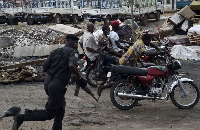 IMage: A police officer pursues fleeing motorcycle taxi riders who refused to stop at mounted barricades to check movement of vehicles and for failing to comply with the sit-at-home order to prevent the spread of COVID-19 coronavirus on Lagos Ibadan expre
