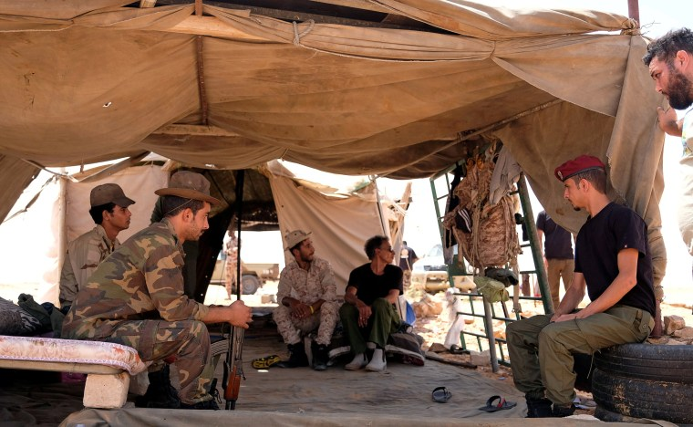 Image: Members of the Libyan National Army (LNA) commanded by Khalifa Haftar sit inside a tent at one of their sites in west of Sirte