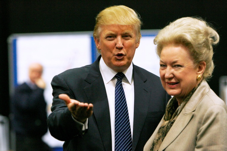 Image: FILE PHOTO: Donald Trump gestures as he stands next to his sister Maryanne Trump Barry, during a break in proceedings of the Aberdeenshire Council inquiry into his plans for a golf resort, Aberdeen