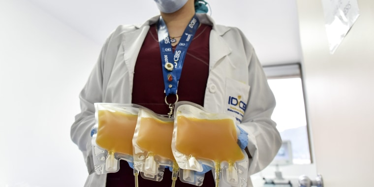 A nurse holds convalescent plasma donated by a man who recovered from COVID-19 in Bogotá, Colombia, on Aug. 14.