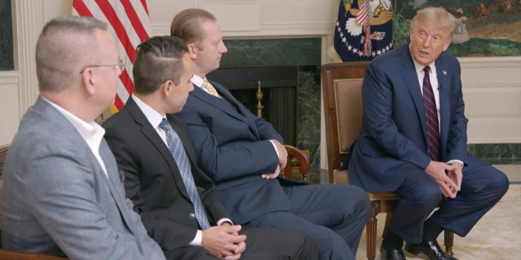 President Donald Trump, from right, speaks wit former hostages at the White House, from left, Pastor Andrew Brunson, Sam Goodwin, and Michael White.