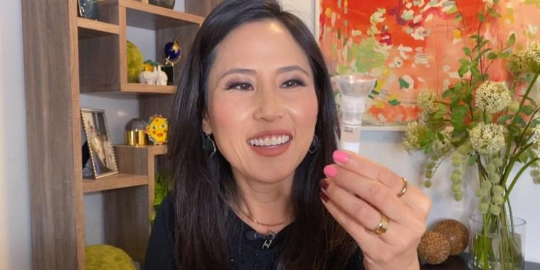 Vicky Nguyen takes a COVID-19 saliva test.