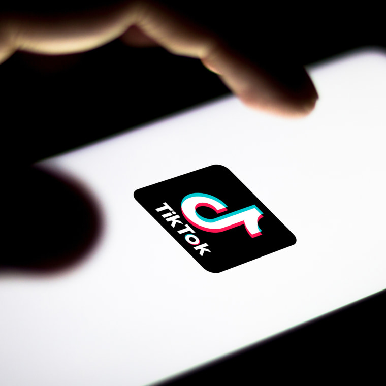 In this photo illustration the TikTok logo seen displayed on