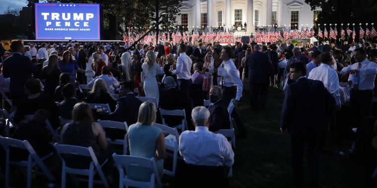 Guests gather to watch President Donald Trump deliver his acceptance speech for the Republican presidential nomination on the South Lawn of the White House on Aug. 27, 2020.