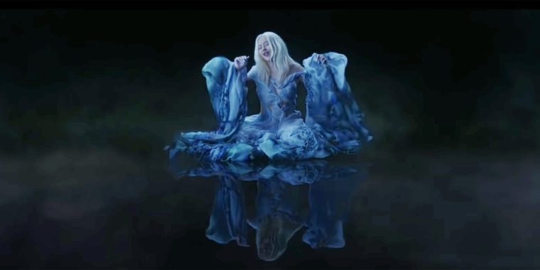 """Christina Aguilera performs in the new music video for an updated rendition of """"Reflection,"""" the theme song of the """"Mulan"""" films."""