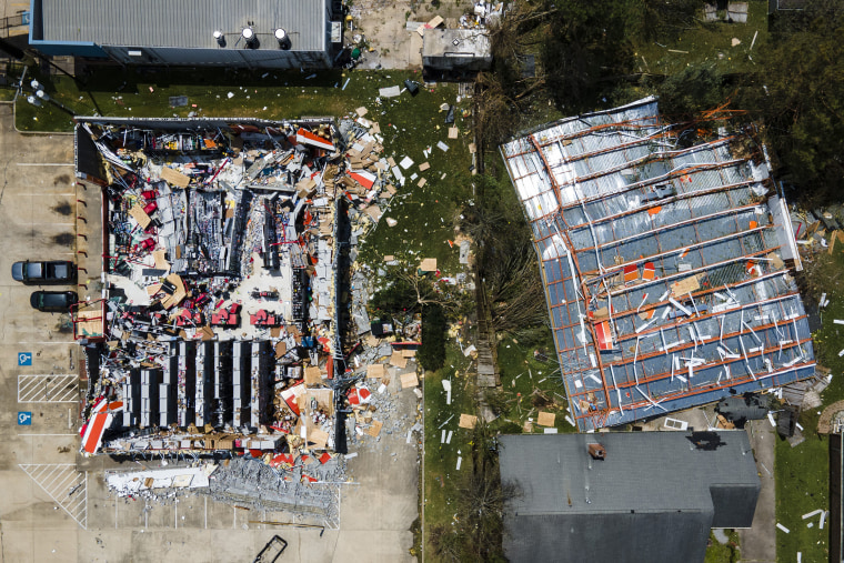 This drone photo shows the roof blown off of an AutoZone store along Nelson Road in the aftermath of Hurricane Laura, Thursday, Aug. 27, 2020, in Lake Charles, La.