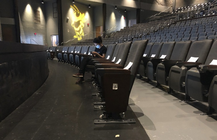 Image: A graduate assistant sits in an empty auditorium during an online lecture on the first day of classes Monday, Aug. 17, 2020, at Georgia Tech in Atlanta.