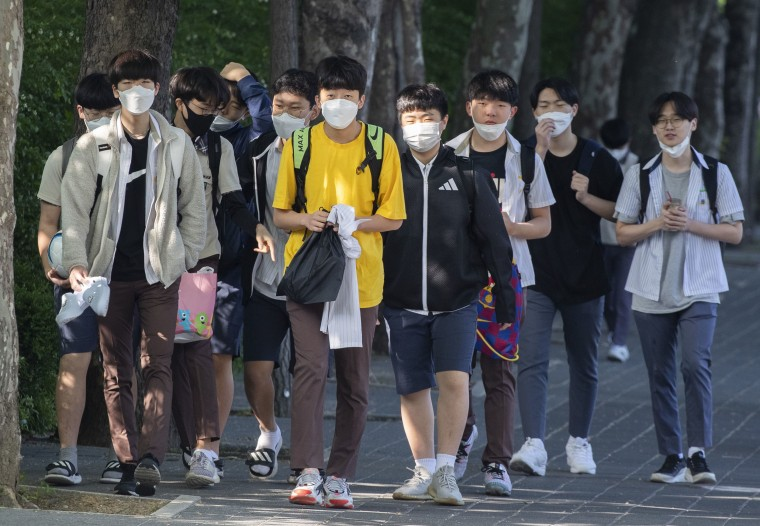 Image: Students return to school for classes at Posung Middle School in Seoul, South Korea