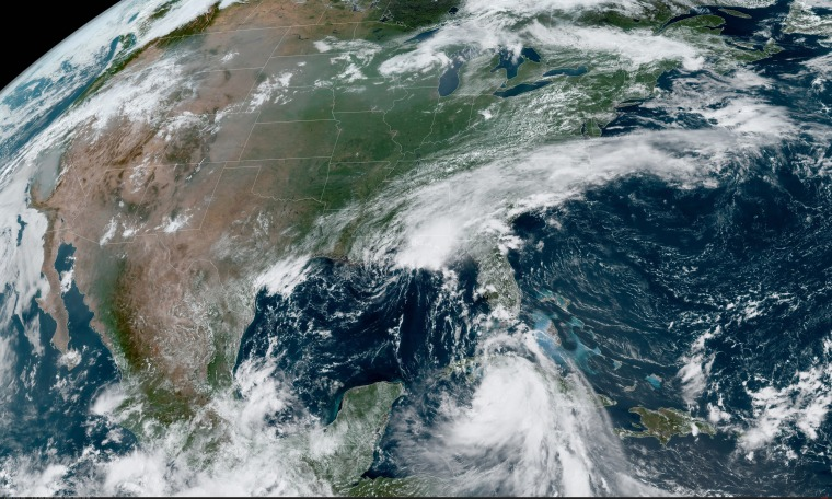 Tropical storms Marco, center, and Laura, bottom.