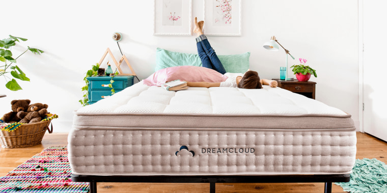 Woman lying on DreamCloud mattress. Labor Day is a great time to buy a mattress. Here is a roundup of this year's hottest mattress sales and promotions.