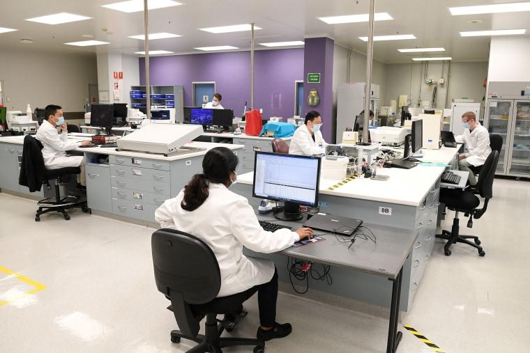 Image: Chemists work at AstraZeneca's headquarters in Sydney, Australia,