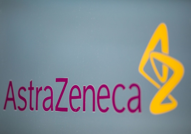 Image: A sign featuring the AstraZeneca Plc logo stands at the company's DaVinci building at the Melbourn Science Park in Cambridge, U.K.