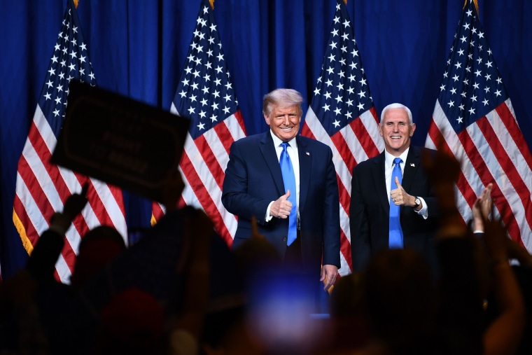 Image: Delegates cheer as President Donald Trump and Vice President Mike Pence stand on stage during the first day of the Republican National Convention