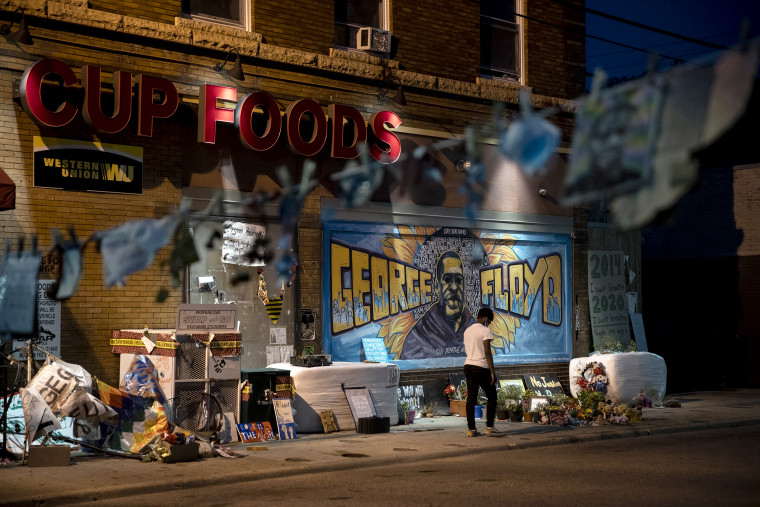 Three months after George Floyd was killed by the police, people visit the memorial set up in his memory in Minneapolis on Aug. 25, 2020.