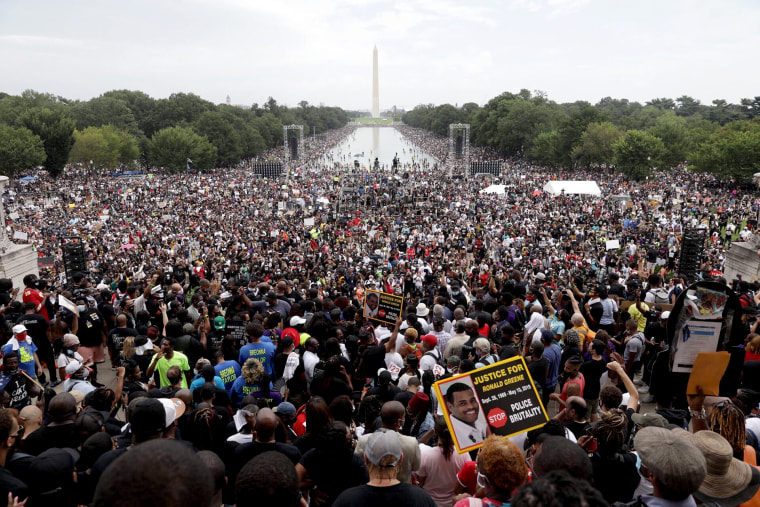 People participate in the March on Washington, on Aug. 28, 2020, at the Lincoln Memorial.