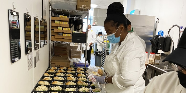 Chef Millie Peartree packs to-go containers with balanced meals for families in need to pick up.