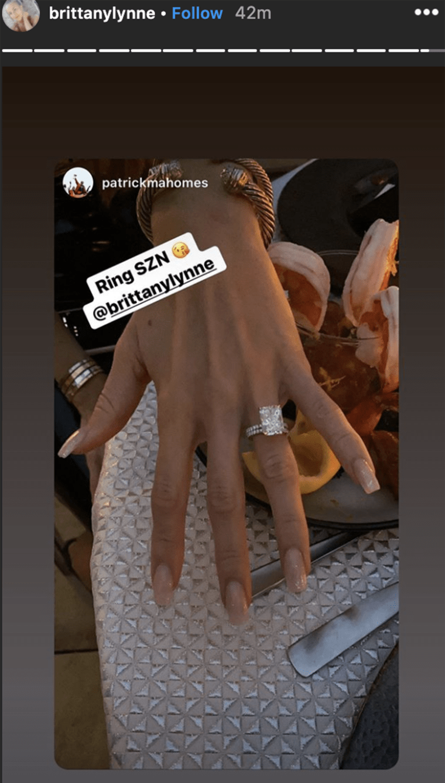 Matthews displays her new engagement ring.