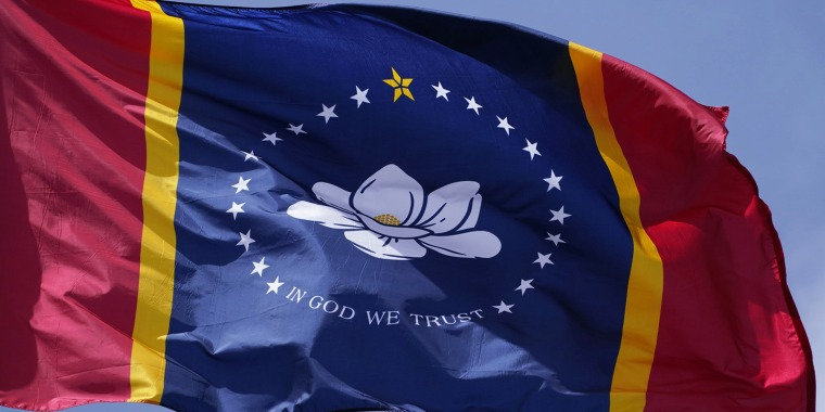"""""""The New Magnolia"""" flag chosen on Sept. 2, 2020 by the Mississippi State Flag Commission flies outside the Old State Capitol Museum in downtown Jackson, Miss."""