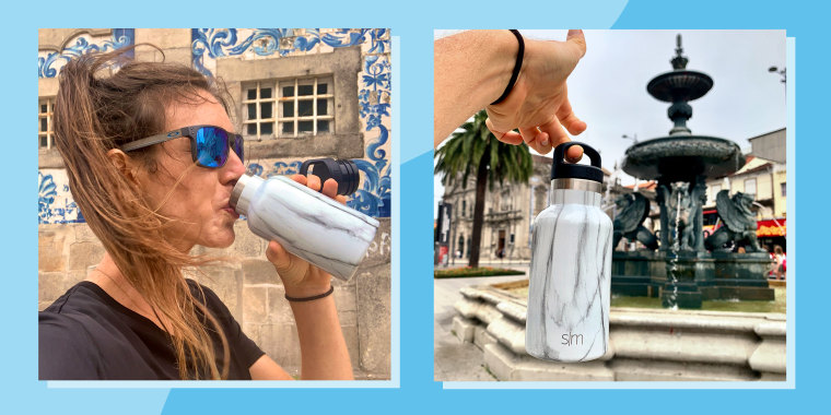 woman drinking and holding marble water bottle