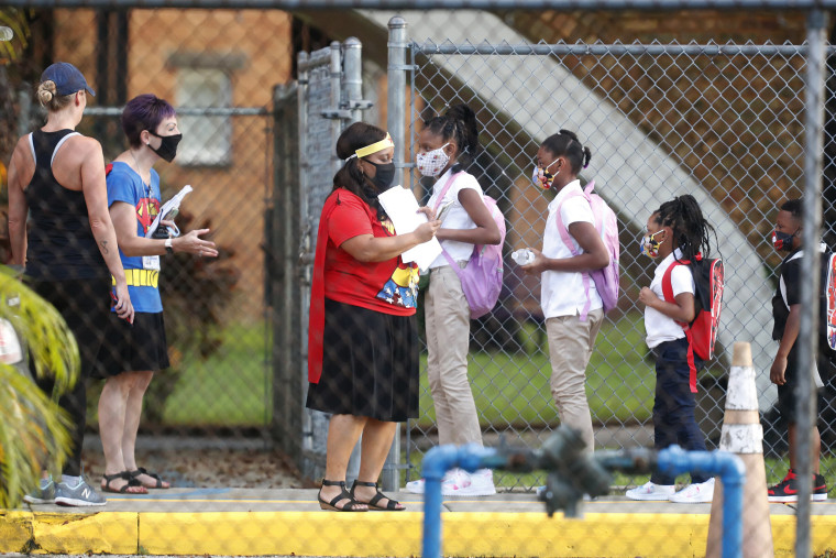 Image: Students return to school at Seminole Heights Elementary School in Tampa, Fla.