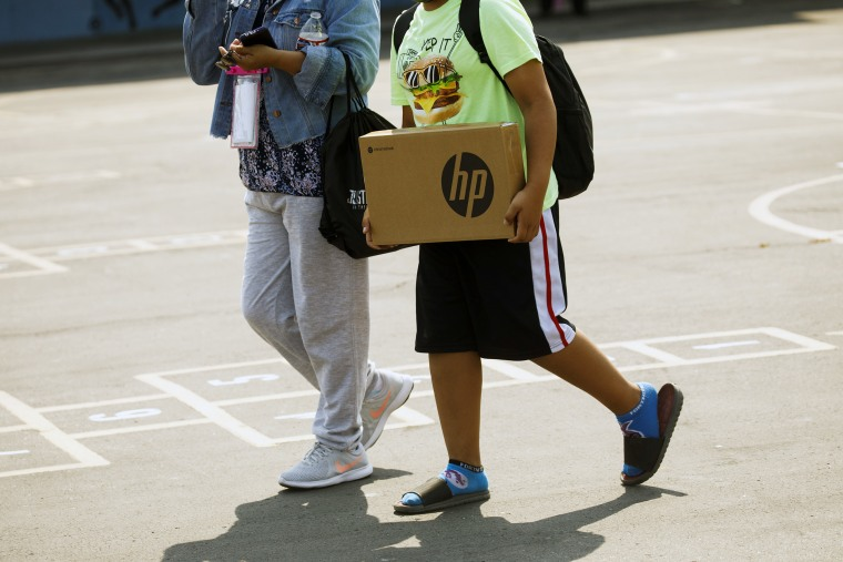 Student Backpack Distribution Event At Compton Avenue Elementary School