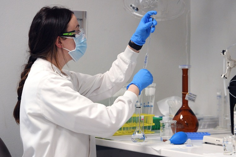 Image: A chemist works at AstraZeneca's headquarters in Sydney