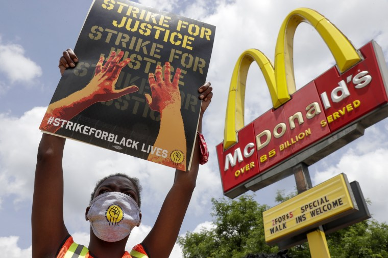 Image: Strike for justice protesters rally outside a McDonald's
