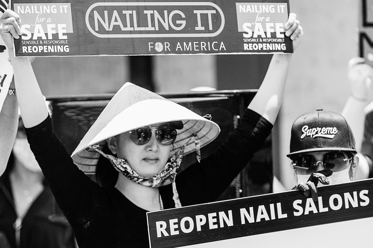 Vietnamese manicurists gather in Westminster, Calif. to call on the state to allow nail salons to reopen on June 8, 2020.