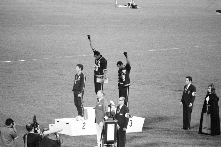 Image: Tommie Smith, John Carlos, Olympic Medalists Giving Black Power Sign