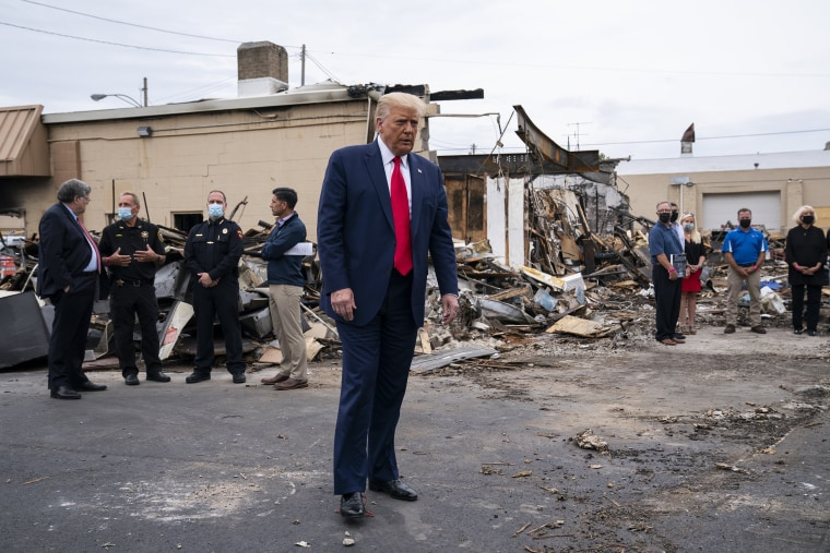 Image: President Donald Trump tours an area on Tuesday, Sept. 1, 2020, damaged during demonstrations after a police officer shot Jacob Blake in Kenosha, Wis.