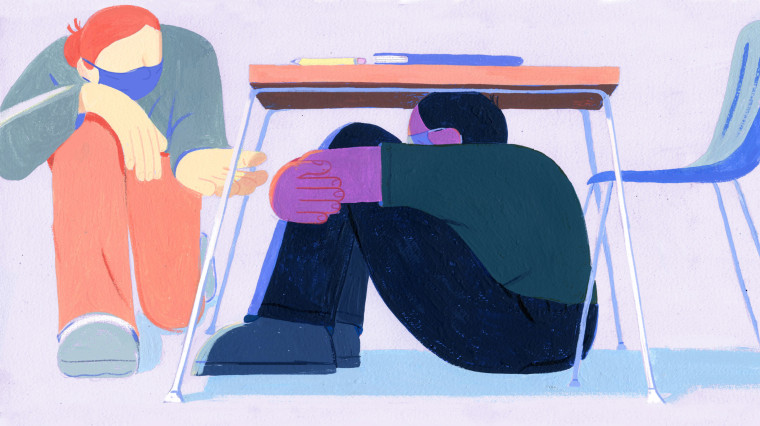 Image: A child hides under a desk while a teacher reaches out to help.