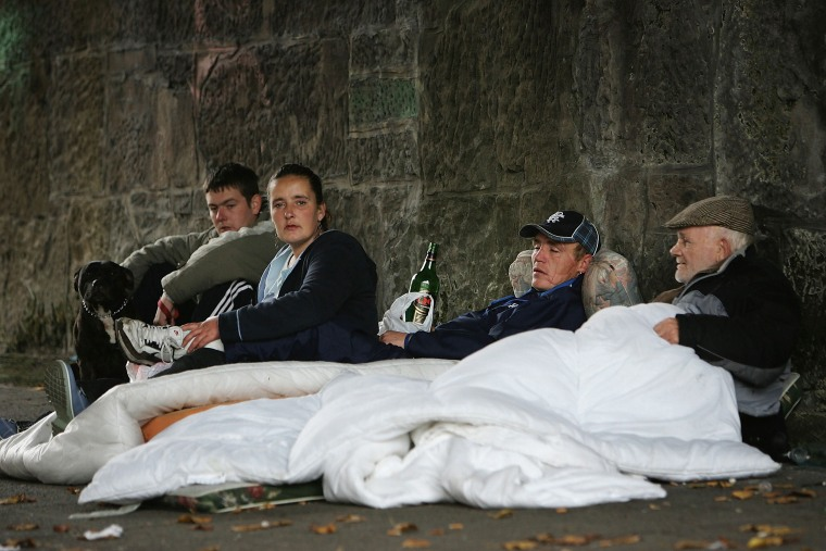 IMage: Homeless people sit under a bridge where they live on the banks of the River Clyde in Glasgow, Scotland.
