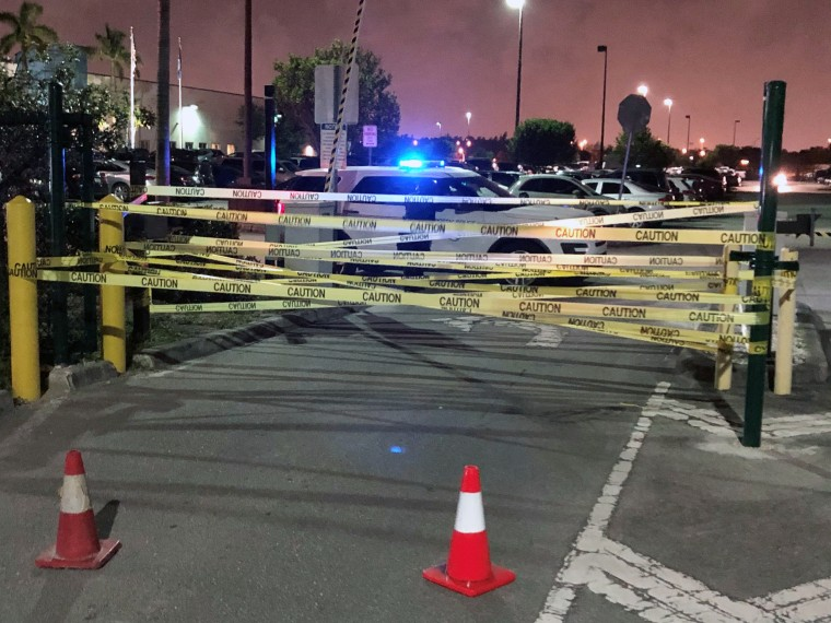 Caution tape and a U.S. Postal Inspection Service police cruiser blocked the entrance of the Royal Palm Processing and Distribution Center in Opa-Locka, Fla., when Rep. Debbie Wasserman Schultz, a Democrat, attempted to enter the facility in the early morning hours of Friday Sept. 4.