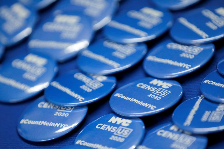Census 2020 merchandise is seen on an information desk at an event where U.S. Rep. Alexandria Ocasio-Cortez (D-NY) spoke at a Census Town Hall at the Louis Armstrong Middle School in Queens, New York City