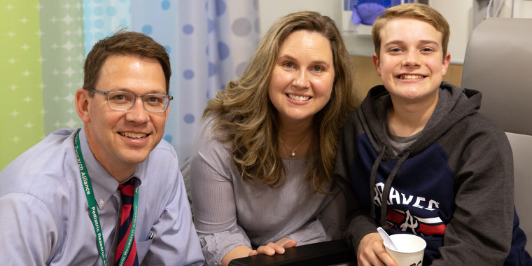 Ian Bicknell, right, poses with his mom Jennifer Bicknell and his allergist Dr. Brian Vickery at Children's Healthcare of Atlanta on the day he received his initial dose of Palforzia in March.