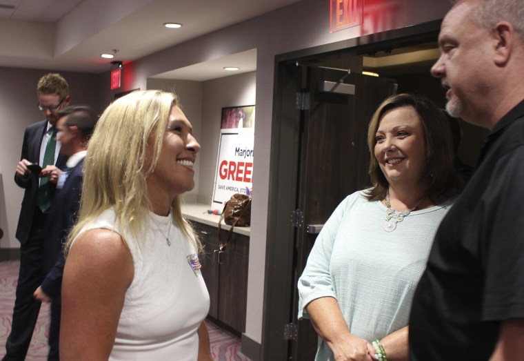 Image: House District 14 candidate Marjorie Taylor Greene talks with attendees at her watch party on at the Courtyard by Mariott in Rome, Ga