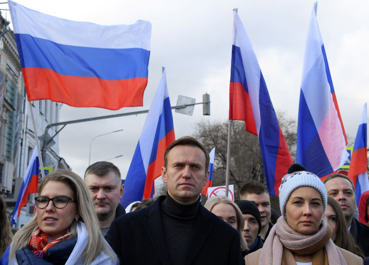 Image: Russian opposition leader Alexei Navalny, his wife Yulia, opposition politician Lyubov Sobol and other demonstrators take part in a march in memory of murdered Kremlin critic Boris Nemtsov