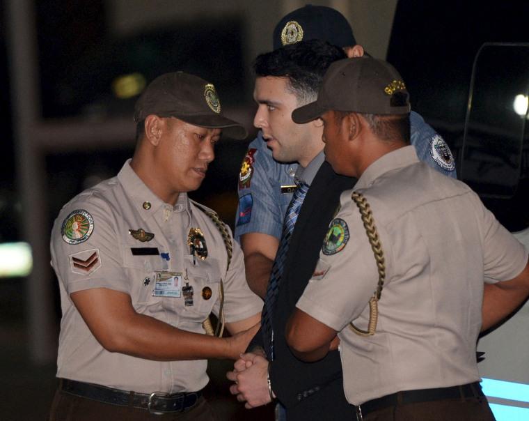 Philippine Bureau of Corrections personnel escort U.S. Marine Lance Corporal Joseph Scott Pemberton at Camp Aguinaldo