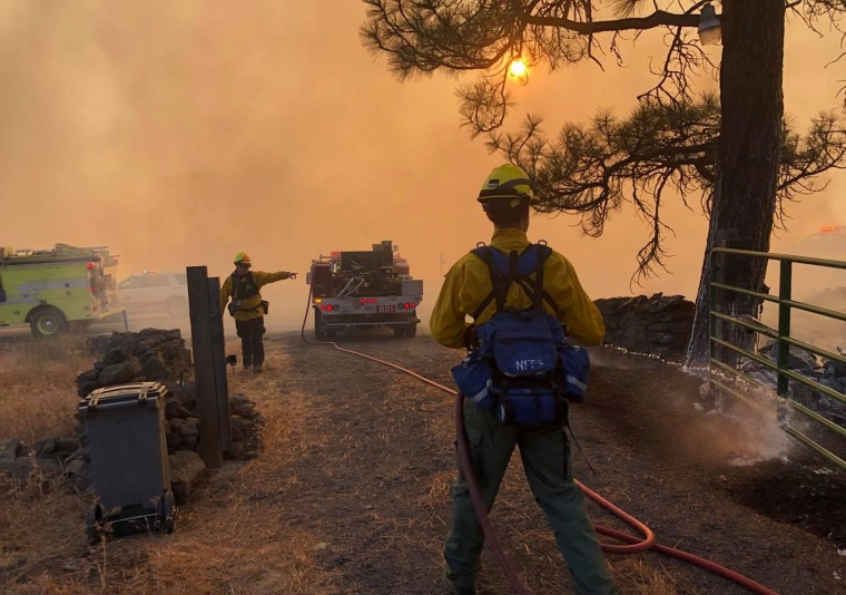 Image: Firefighters battle flames in Colfax, WA on Sept. 8, 2020.