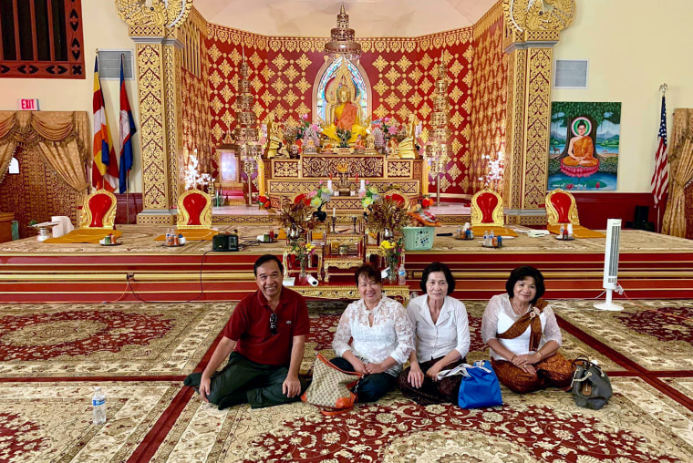 Participants in a wellness program observe Kan Ben, one of the most important spiritual activities among Cambodian Buddhists, at a temple in Long Beach, Calif., in 2019.