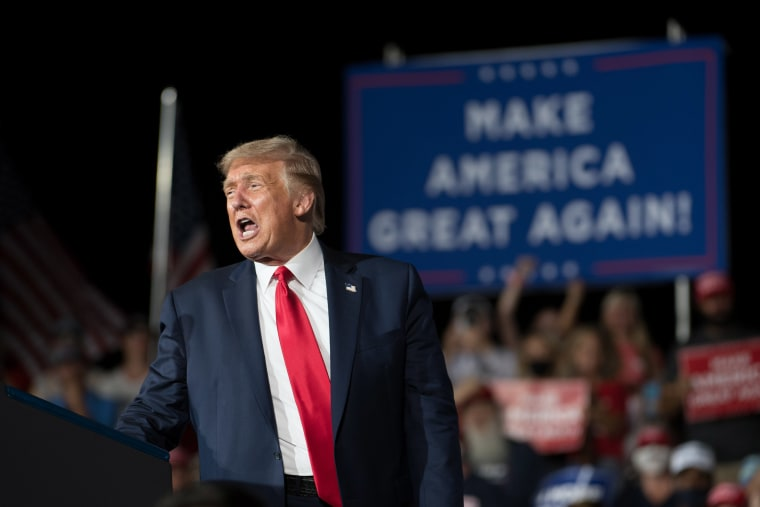 Image: President Donald Trump addresses the crowd during a campaign rally at Smith Reynolds Airport on Sept. 8, 2020 in Winston Salem, NC.
