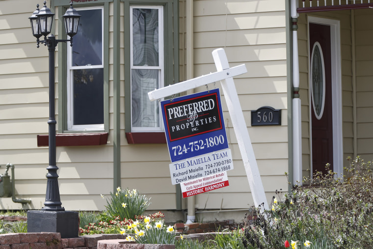 Image: A real estate company sign that marks a home for sale in Harmony, Pa.