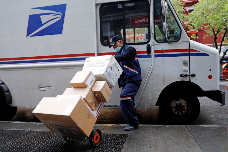 Image: United States Postal Service (USPS) worker unloads packages in Manhattan during outbreak of coronavirus disease (COVID-19) in York