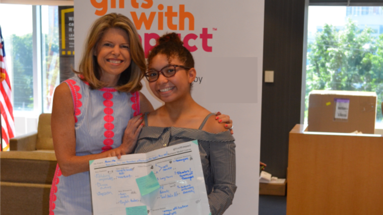 Girls With Impact CEO Jennifer Openshaw with Kristen St. Louis, who graduated from the program.