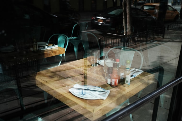 Image: An empty table at a permanently closed restaurant in New York City