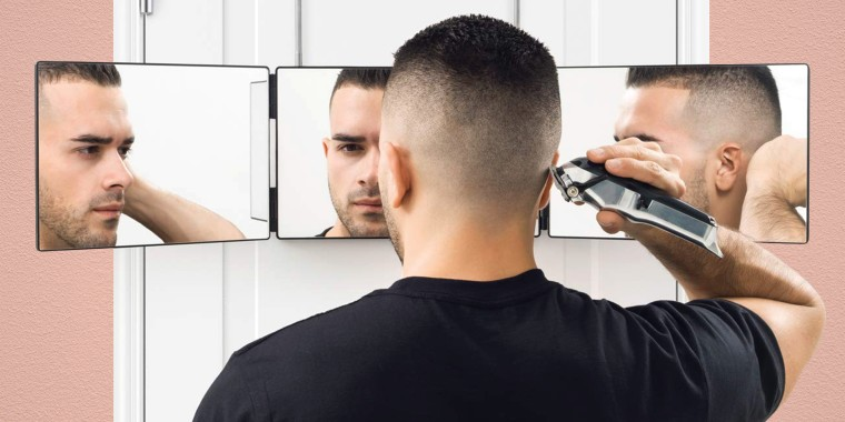 man giving himself a haircut with electric razor in three way mirror. For men who seriously need a haircut, it's time to take matters into your own hands. Check out products for a DIY haircut from Wahl, ArtNaturals and more.