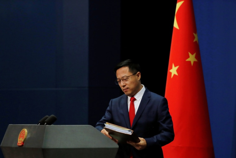 Image: Chinese Foreign Ministry spokesman Zhao Lijian attends a news conference in Beijing, China